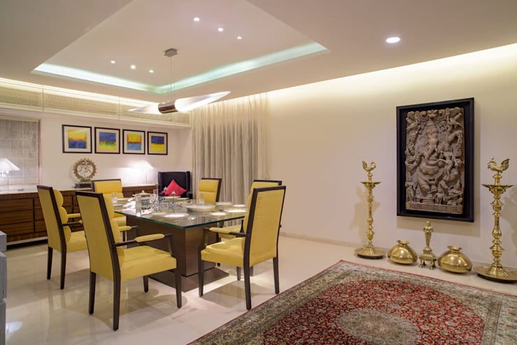 Premium home designs:  Dining room by Bric Design Group