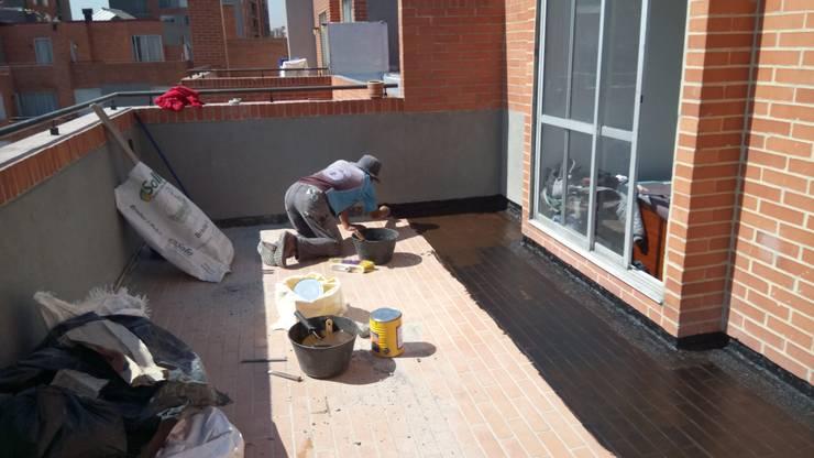 imprimacion Balcones y terrazas de estilo moderno de CELIS & CELIS INGENIEROS CONSTRUCTORES S.A.S Moderno