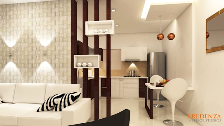 MODERN DINING DESIGNS FOR SHRI SAI SRUSHTI APARTMENT:  Dining room by Kredenza Interior Studios