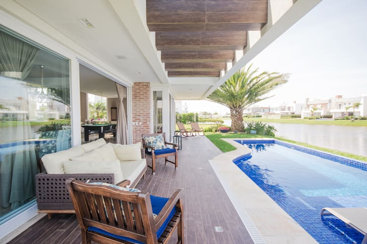 Casas de estilo  por Arquiteto Vinicius Vargas