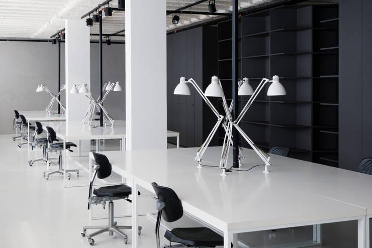 Office buildings by Studio Komo, Modern