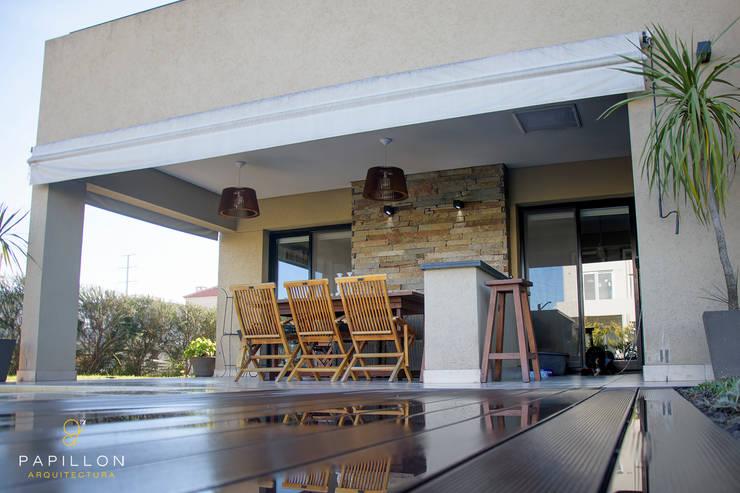 Casa 205: Casas de estilo  por Papillon Arquitectura,
