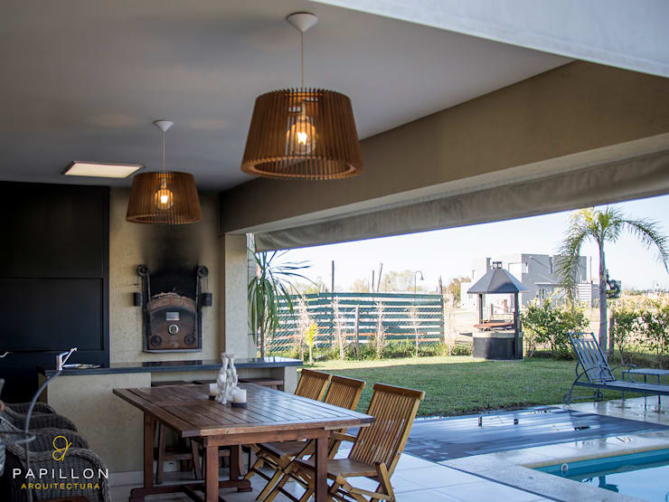 Casas de estilo ecléctico por Papillon Arquitectura
