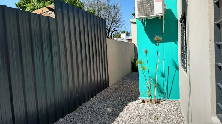 CENTRO MEDICO ROLDAN: Casas unifamiliares de estilo  por ECOS DE SOL (Ingeniería y Construcción),