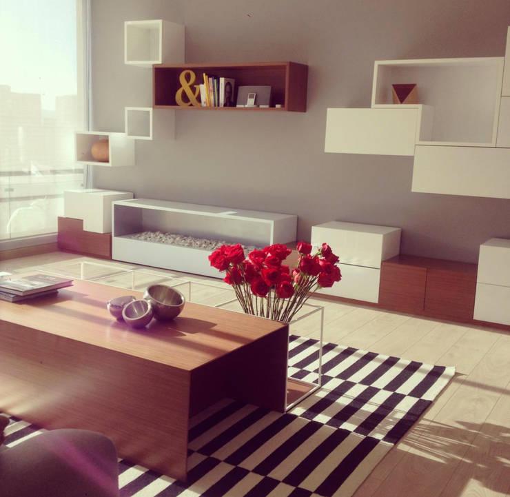 LOS ROSALES: Salones de estilo  por D Interior