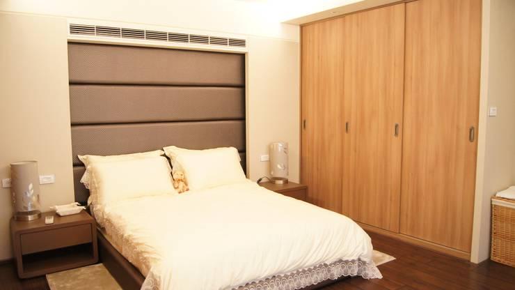 南屯住宅設計:  臥室 by 欣成室內裝修設計股份有限公司
