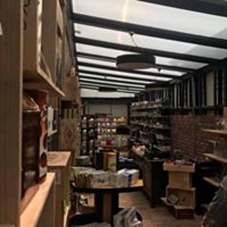 Delikatessen Bogota: Locales gastronómicos de estilo  por Heritage Design Group