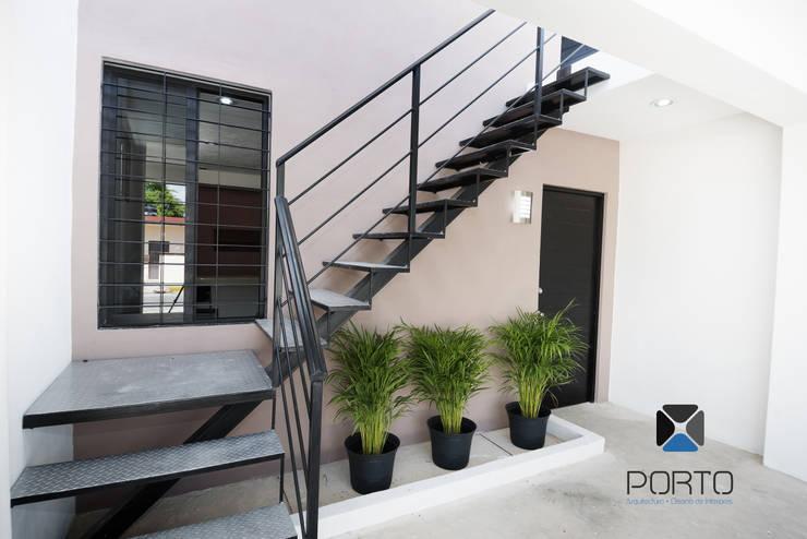 Houses by PORTO Arquitectura + Diseño de Interiores