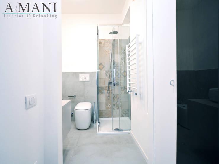 Bagno: Bagno in stile  di A4MANI - Interior & Architecture