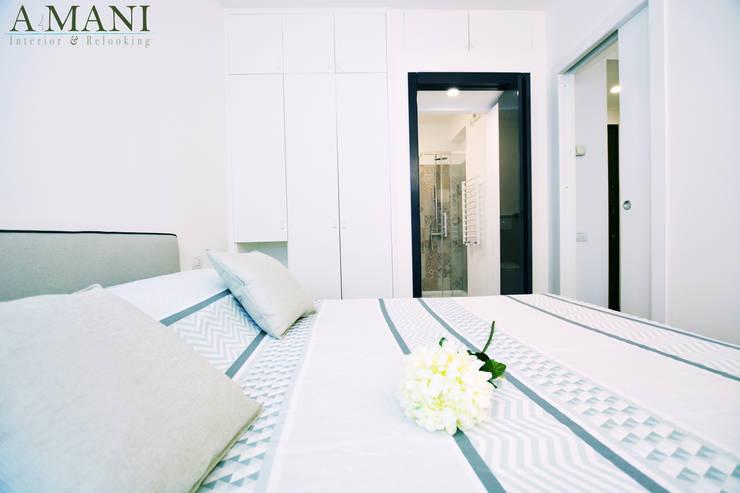 Camera Padronale: Camera da letto in stile  di A4MANI - Interior & Architecture