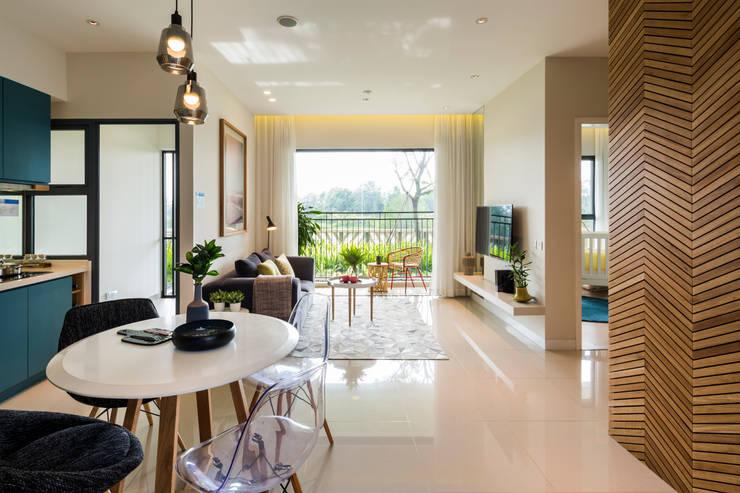 Palm Heights:  Phòng khách by MIA Design Studio