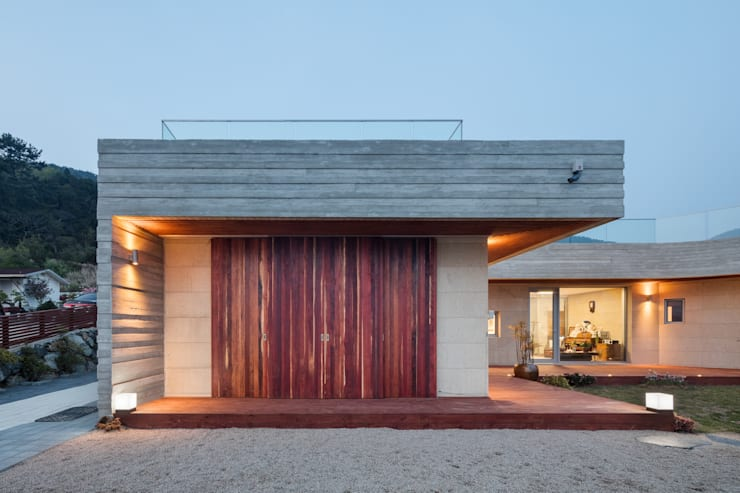 Casas de estilo  por 투엠투건축사사무소