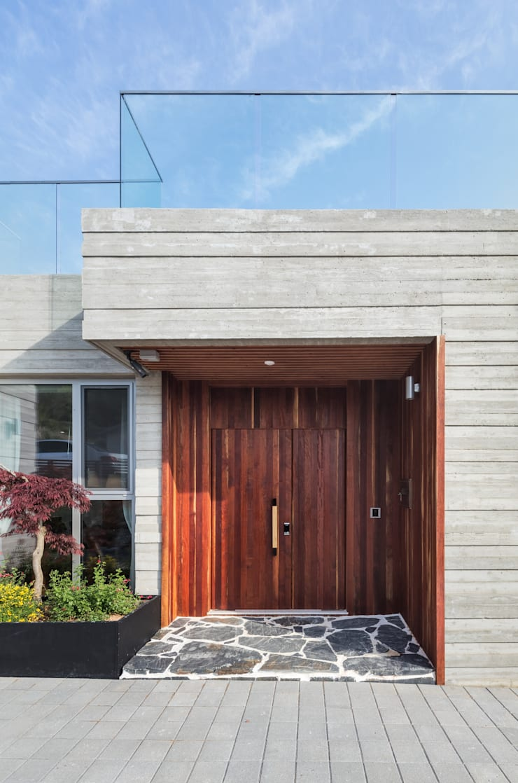 Puertas de estilo  por 투엠투건축사사무소, Moderno