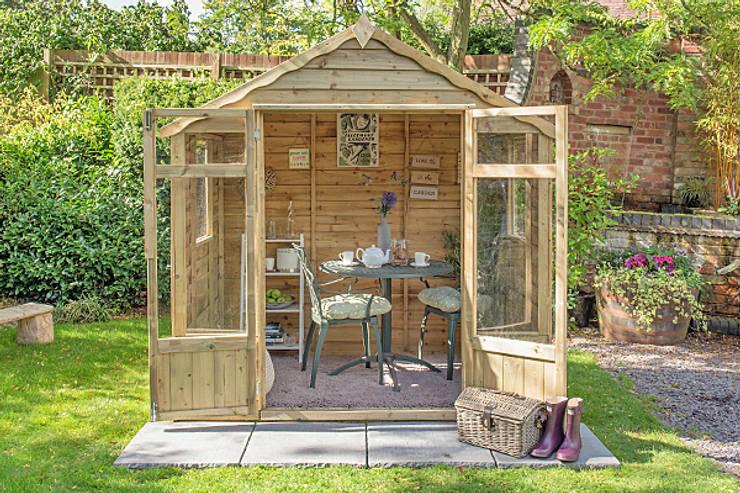 Oakley Summerhouse:  Garages & sheds by Wonkee Donkee Forest Garden