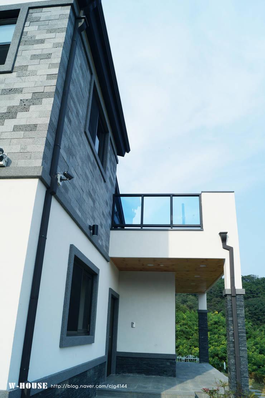 오창 50평형 ALC전원주택: W-HOUSE의  전원 주택