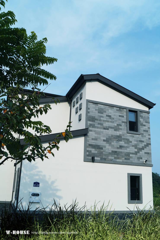 오창 50평형 ALC전원주택: W-HOUSE의  주택