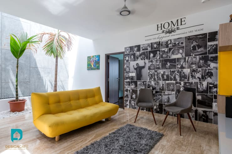 Mr Harsh's Residential Project- :  Living room by Design  Cafe
