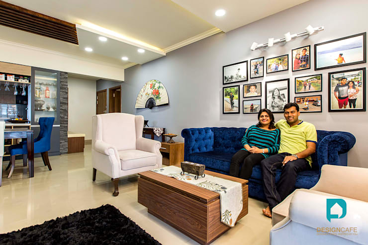 Palak and Vishal's- Residential Project:  Living room by Design  Cafe