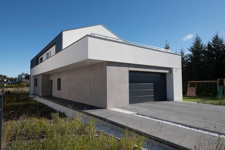 Dom jednorodzinny w Chybach koło Poznania: styl nowoczesne, w kategorii Domy zaprojektowany przez Offa Studio