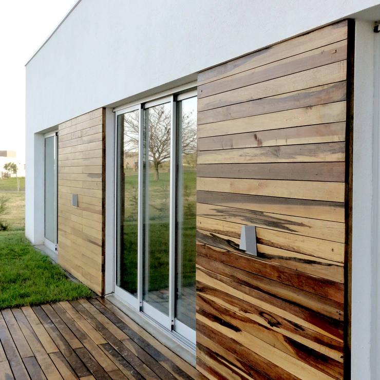 Casa Moderna MAX: Casas de estilo  por Estudio Zanolo,