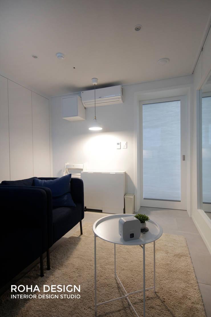 부산 북유럽 스타일 복층 아파트 인테리어: 로하디자인의  거실