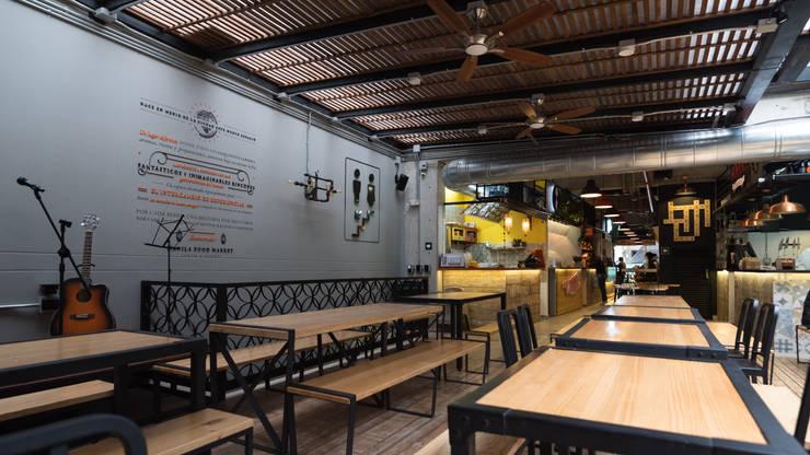 MANILA MARKET: Locales gastronómicos de estilo  por PLANTA BAJA ESTUDIO DE ARQUITECTURA