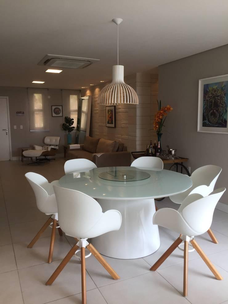 Casa de Praia:  Dining room by brunadiogenes.liviafeitosa