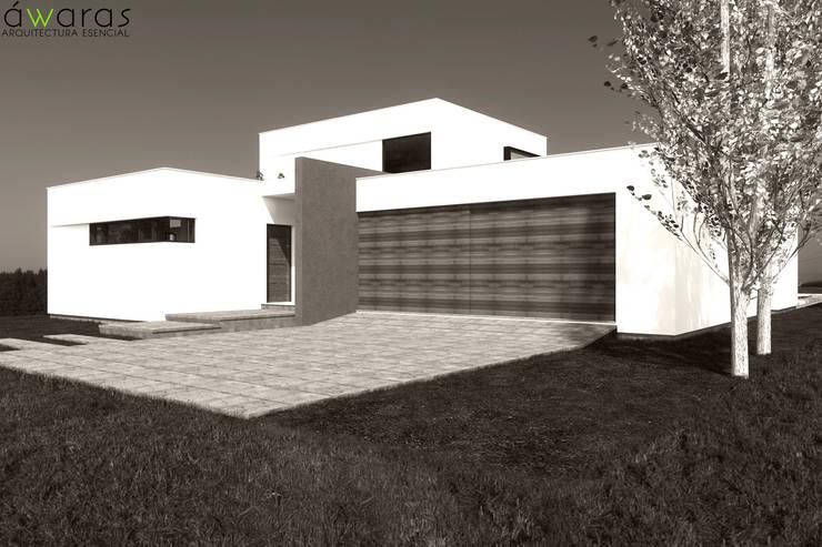 CASA LC | FRENTE NORTE: Casas unifamiliares de estilo  por áwaras arquitectos