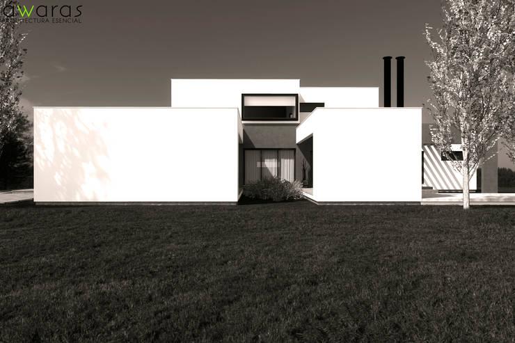 CASA LC | FRENTE OESTE: Casas unifamiliares de estilo  por áwaras arquitectos