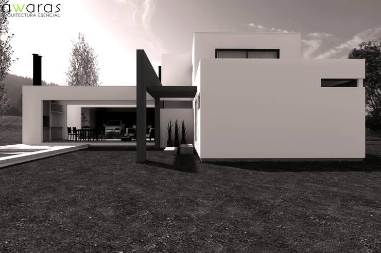 CASA LC | FRENTE SUR: Casas unifamiliares de estilo  por áwaras arquitectos