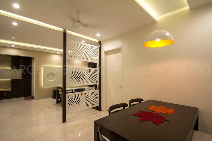 1500 Sft Residence at Rohan Kritika, Sinhagad Road, Pune :  Dining room by Archilab Design Solutions Pvt.Ltd.