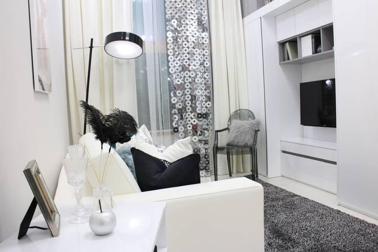 미니멀 럭셔리를 구현한 거실공간: 모린홈의  상업 공간