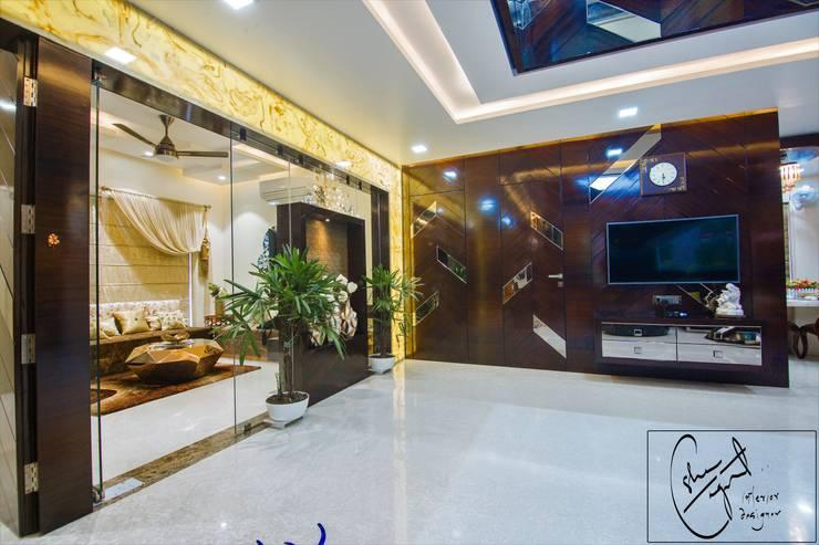 Goel's, Aanandam World City, Raipur:  Living room by ES Designs