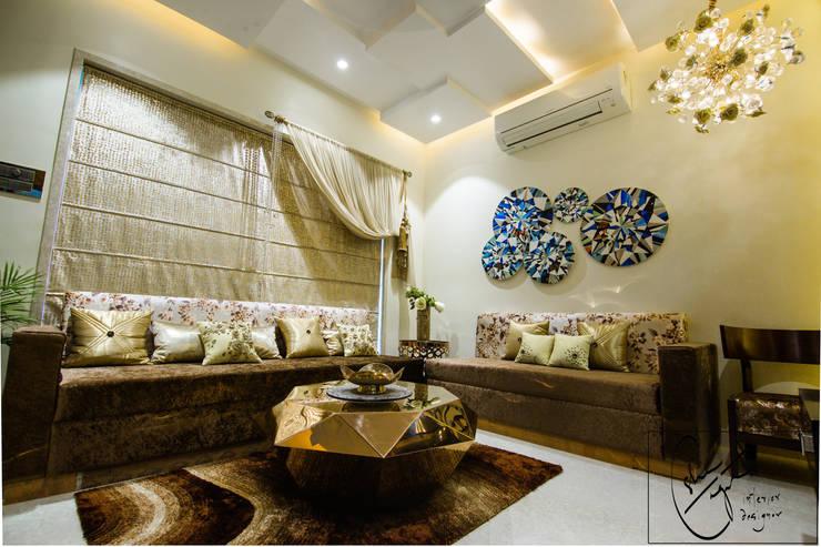 Goel's, Aanandam World City, Raipur: modern Living room by ES Designs