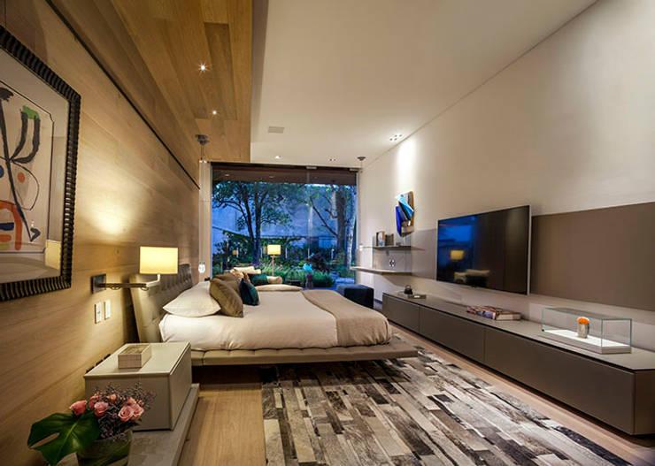 Cuartos de estilo moderno por Eduardo Gutiérrez Taller de Arquitectura