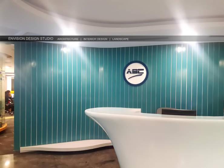 Reception Area:   by Envision Design Studio