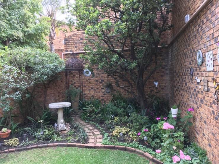 Corner of the Garden after revamp:   by Hedgehog Landscapes