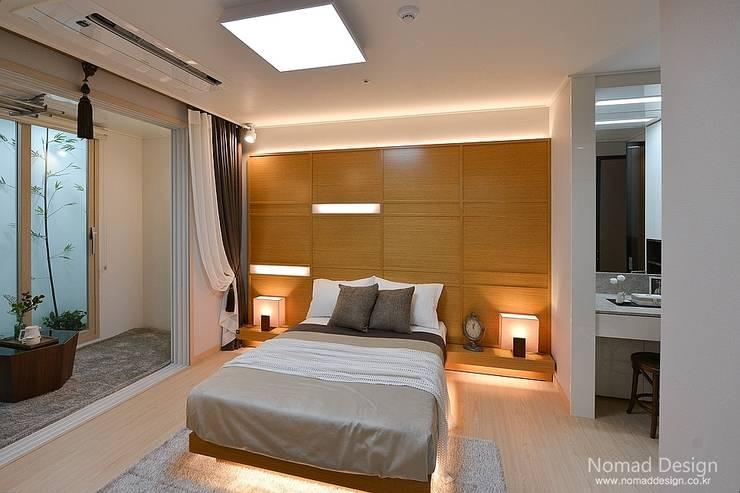 부산 호텔을 컨셉으로한 24평 아파트(2): 노마드디자인 / Nomad design의  침실