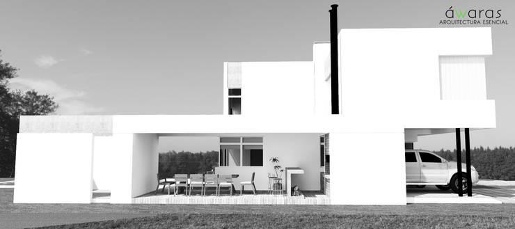 FRENTE ESTE: Casas de estilo  por áwaras arquitectos,