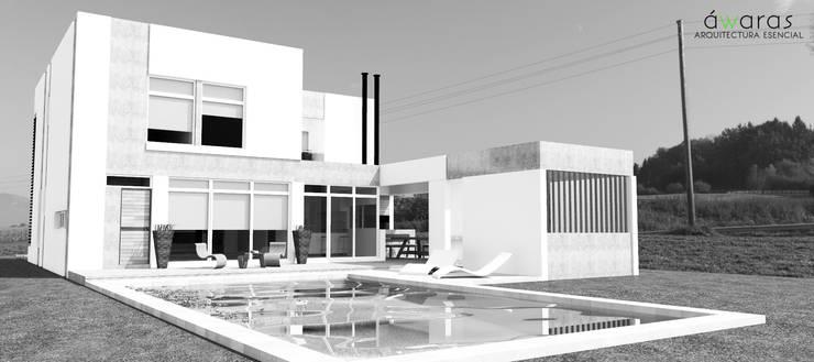 FRENTE SUR: Casas de estilo  por áwaras arquitectos,