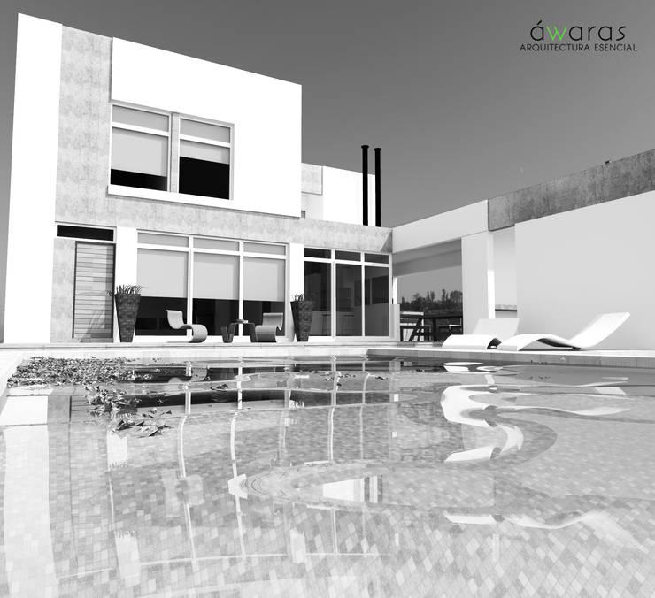 FRENTE SUR - PISCINA : Casas de estilo  por áwaras arquitectos,