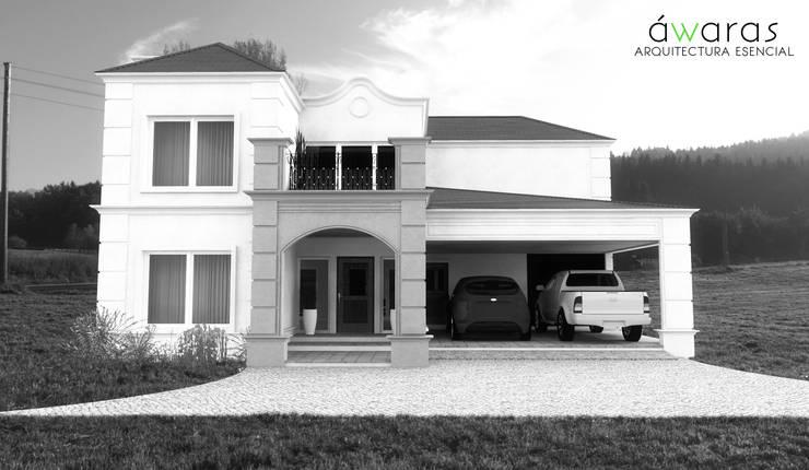 CASA PM | FRENTE OESTE : Casas de estilo  por áwaras arquitectos,