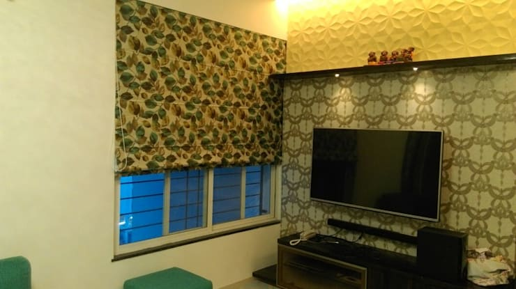 Hill Shire, Wagholi:  Living room by Area Planz Design