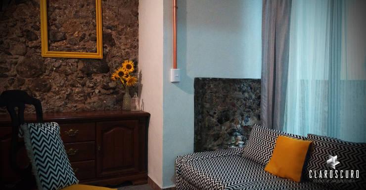 ESTANCIA: Salas de estilo  por CLAROSCURO ESTUDIO DE ARQUITECTURA