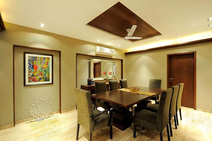 Mumbai Residence,:  Dining room by DesignTechSolutions