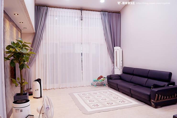 익산 임상리 50평형 ALC주택: W-HOUSE의  거실,모던 석회암