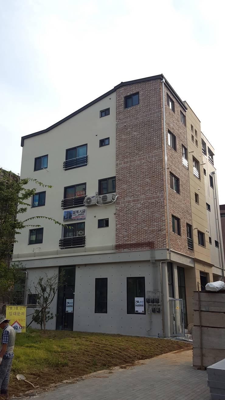 하남 상가주택: 엘손건축사사무소의  주택