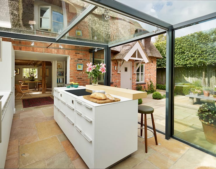 Glass box extension on thatched cottage:  Kitchen by Kitchen Architecture