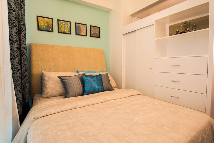 Malayan Plaza:  Bedroom by TG Designing Corner