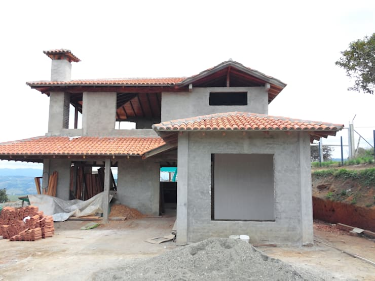 Casas de campo de estilo  por Arcor Constructores ,